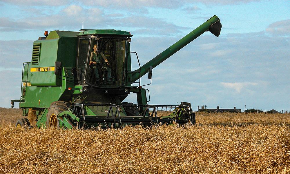 Combine harvester JOHN DEERE 1166